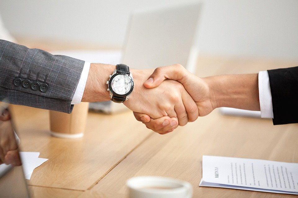 Closeup View Of Handshake, Two Businessmen In Suits Shaking Hand